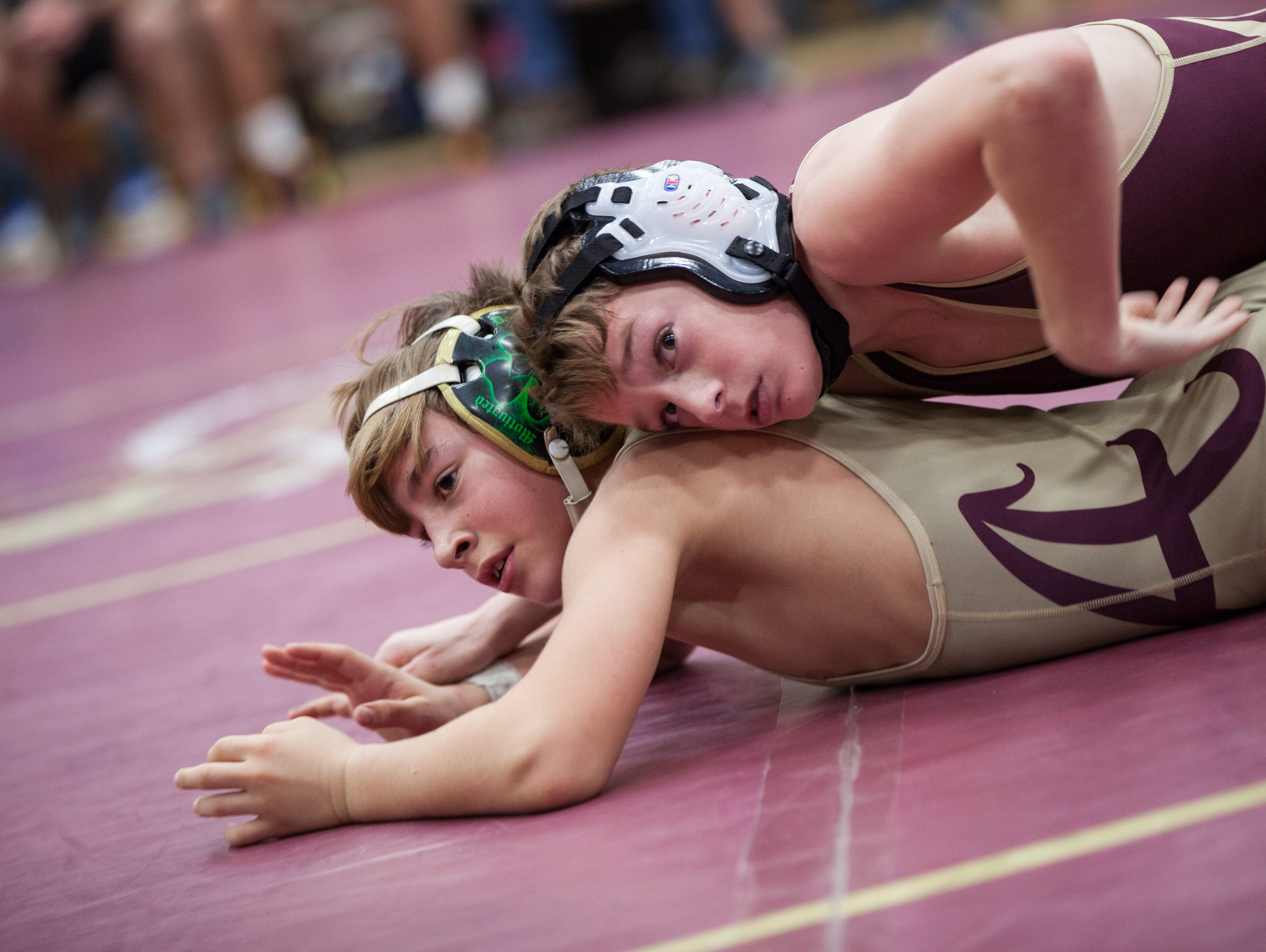 Arlington High School wrestlers Dennis Robin, above, and Tim Bova tangle in the 99-pound final at the Mid-Hudson Invitational at Arlington on Dec. 28.