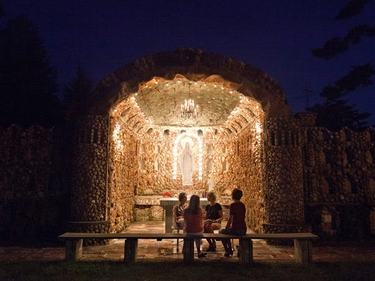People gather at the Mother of God grotto in Jasper, Indiana.
