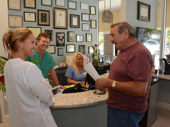 Patient Heinz Roessler talks with dental assistant Cindy Hamilton. Dr. Rick Siegel has opened his full-service dentistry practice, with offices at the Shops of Marco.