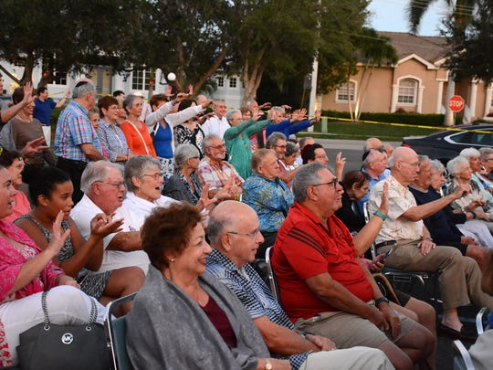 The congregation in the parking lot responds to Rabbi Mark Gross. The Jewish Congregation of Marco Island held a Hanukkah celebration on Thursday evening outside the temple on Winterberry Drive.