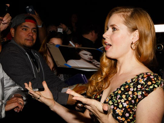 Amy Adams greets fans upon arriving at the Palm Springs International Film Festival, Monday, Jan. 2, 2017.