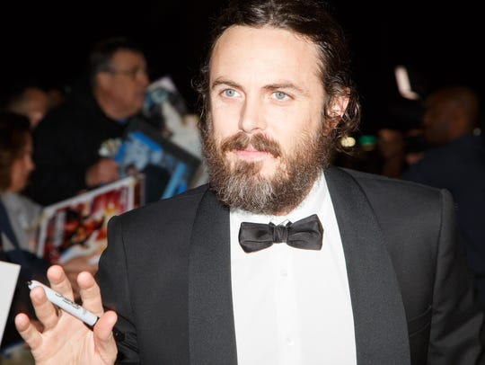 Casey Affleck greets fans upon arriving at the Palm