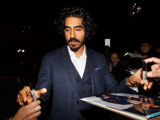 Dev Patel signs autographs at the Palm Springs International Film Festival, Monday, Jan. 2, 2017.