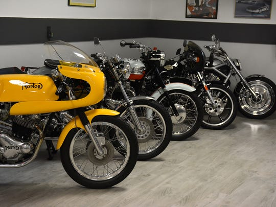 The motorcycle corner, with Harley-Davidson, Triumph, Notron, and Ducati. Owning 16 collectible - and drivable - cars, plus six classic motorcycles, Marco Islander Bill Young built a house to hold them, with the entire ground floor laid out as a 16-car garage.