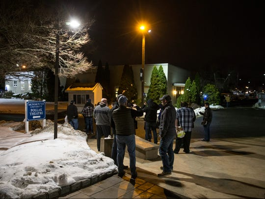 Fans of Bruce Springsteen enter the Pollak Theater