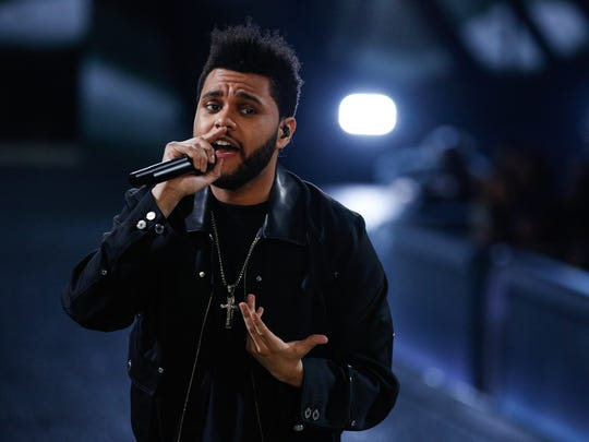 PARIS, FRANCE - NOVEMBER 30:  The Weeknd performs on