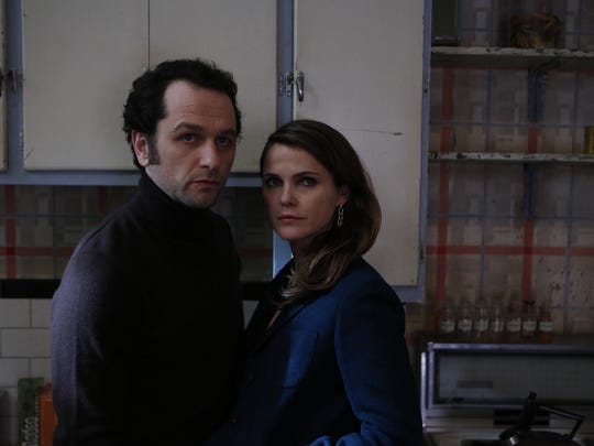 "in ""The Americans,"" Matthew Rhys portrays Philip Jennings and Keri Russell portrays Elizabeth Jennings."