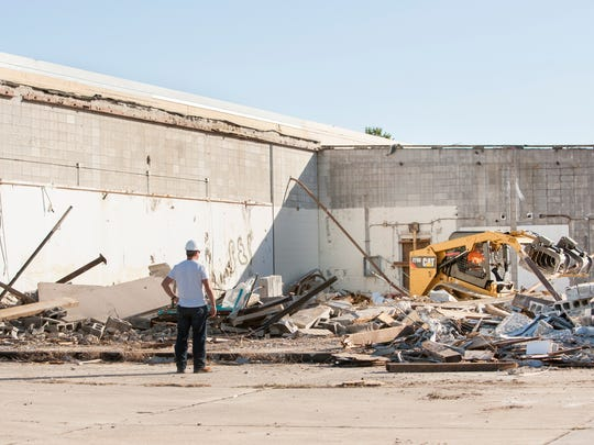 The building that housed the former Delchamps supermarket on Gulf Breeze Parkway is being demolished in Gulf Breeze on January 11, 2017.
