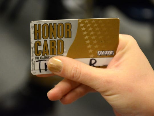 The kid's equivalent of an American Express Gold Card - Parents of Tommie Barfield students have protested the school's decision to stop giving students honor cards to reward academic achievement.