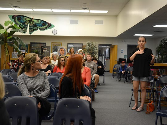 Parent Mylea Scuderi speaks during the SAC meeting Tuesday evening. Parents of Tommie Barfield students have protested the school's decision to stop giving students honor cards to reward academic achievement.