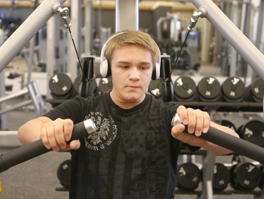 Josh Morgan, 16, of Middletown, works his arms on the