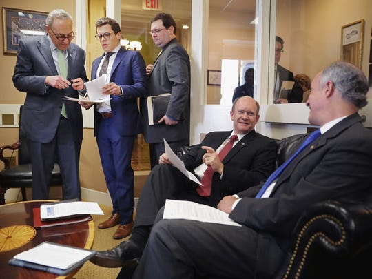Sen. Charles Schumer (D-NY) (L) talks with staff members as he and Sen. Chris Coons (D-DE) and Sen. Robert Casey (D-PA) (R) prepare for a news conference following meetings between Republican presidential candidate Donald Trump and GOP congressional leadership at the U.S. Capitol May 12, 2016 in Washington, D.C. The Senate Democrats pointed to policies they say that Trump and Republicans in Congress agree on and said they were both operating from the same textbook.