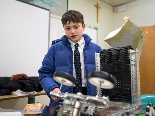 Seton Catholic Central ninth-grader Gabe Rogers works on his robot during a meeting of the robotics club on Jan. 17.