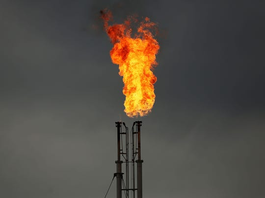 Natural gas is flared off at a plant outside of the