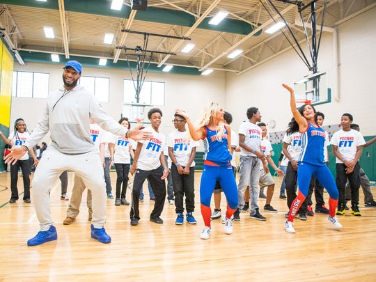 Detroit Pistons center Andre Drummond leads exercises during an NBA FIT clinic Thursday at Bethune Elementary in Detroit.