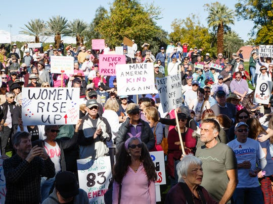 Hundreds gather to march through Palm Desert in protest of Donald Trump's presidency, Saturday, Jan. 21, 2017.
