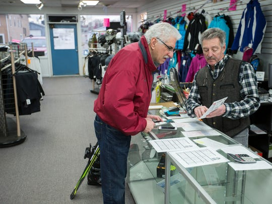 Cliff Conger chats with customer Neisen Luks, of Endwell, at Cliff House ski shop on Tuesday, Jan. 23.