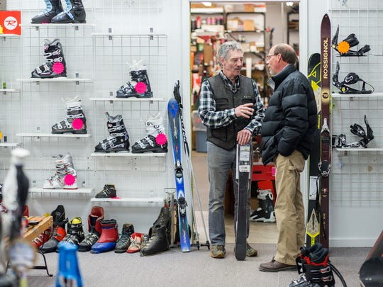 """Cliff Conger chats with a customer on Tuesday, """"The people made it everything that it is today. It's not about me, but the people who supported the business,"""" Conger said."""