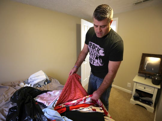 Bart Conley keeps some of his late wife's clothes in his closet.