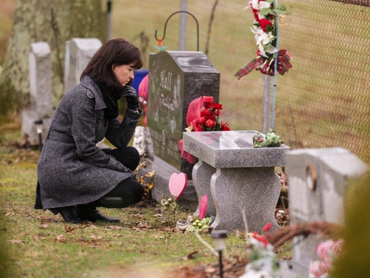 Jennifer Powell visits the gravesite of her younger