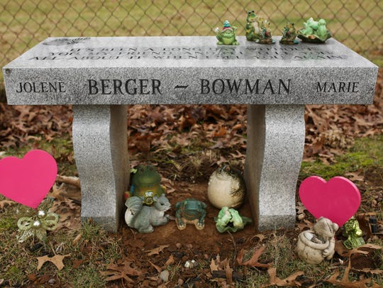 Frogs and hearts decorate the tombstone of Jolene Berger-Bowman,