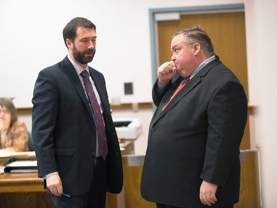 Senior Assistant Public Defender Jon Rothermel, left,