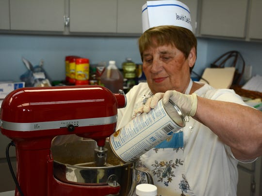 Deli Fest chairman Estee Karpman makes a batch of matzoh balls. The Jewish Congregation of Marco Island is hosting their annual Deli Fest, this Sunday at the temple on Winterberry Drive.