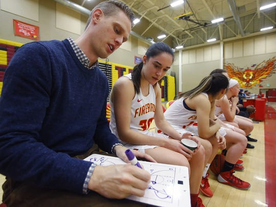 Chaparral High School basketball coach Brian Porth goes over what Brenna Doyle missed at halftime during action against North Canyon High Wednesday, Jan. 25, 2017 in Scottsdale, Arizona.