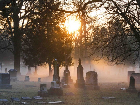 A morning blanket of fog covers Crown Hill Cemetery