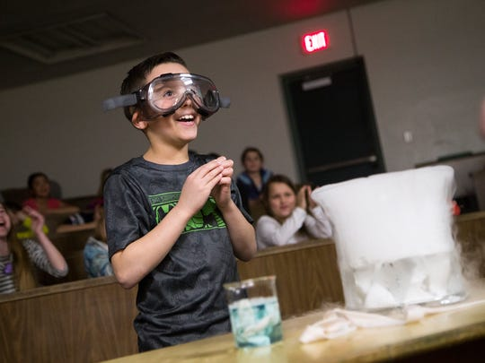 Fourth-grader Tyler Waddell, 9, smiles after having his fortune told as part of a chemistry experiment in the chemistry magic show at Vestal High School students on Wednesday.