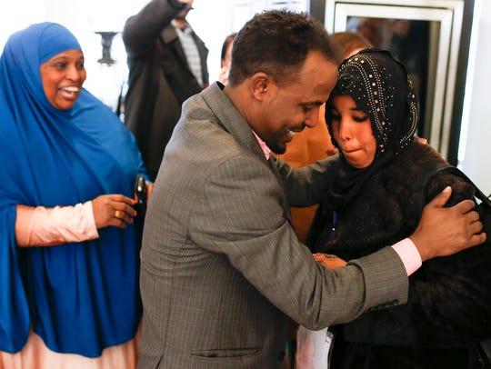 Barkat Mohamed, left, embraces his wife, Zemzem Abib,