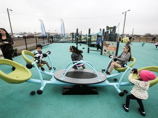 Children enjoy the play structures Saturday, Feb. 4, 2017, during the grand opening of the Play-for-All Playground at Salinas Park in Corpus Christi.