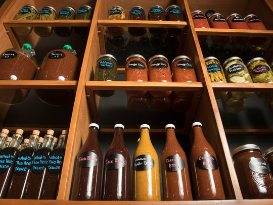 Bottles of homemade sauces and condiments made by Chef