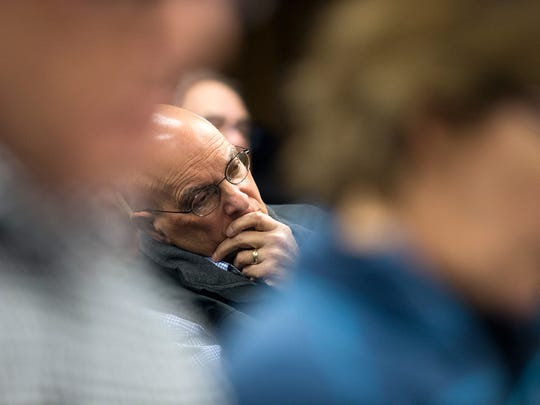 Binghamton resident Wayne Rozen listens during Thursday's Zoning Board of Appeals meeting where a plan to expand Hayes Student Living was rejected. Rozen said he knew parties on both sides of the issue and was interested in how the board would rule.