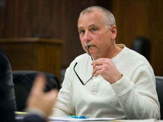 """Vestal's Zoning Board of Appeals chairman Mark Johnson listens to a plan to expand the Hayes Student Living project at Vestal Town Hall on Thursday. Johnson voted to deny the project request calling it """"substantial""""."""