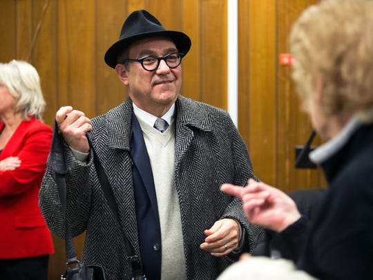Jeffrey Feinberg, owner of Hayes Student Living, gathers his belongings after the Vestal Zoning Board of Appeals rejected key zoning code variances for his proposed project to expand the facility.