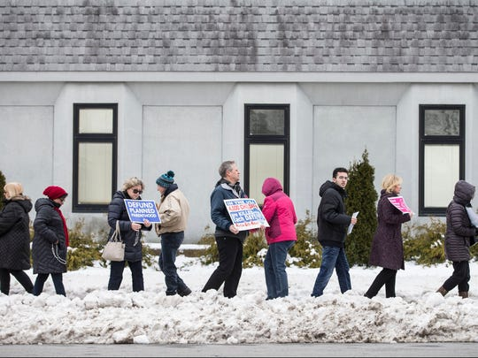 Activists hold a rally in front of Planned Parenthood on Newman Springs Road as part of a nationwide campaign to defund the organization.Shrewsbury, NJSaturday, February 11, 2017.@dhoodhood