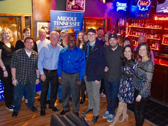 MTSU President Sidney A. McPhee (center) is joined by Grammy-winner and alumnus Luke Laird (right of McPhee) and Ken Paulson, dean of the College of Media and Entertainment (left of McPhee) at a reception Saturday before Americana Music Association and MTSU's concert honoring Loretta Lynn at the Troubadour in West Hollywood, Calif.