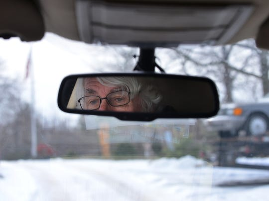 "Jerry McSpirit ,reflected in his rear-view mirror. McSpirit has been providing antique cars and trucks for movies, parades and actors for more than 40 years. Most recently, he rented 20 cars for the movie ""Fences,"" starring Denzel Washington."