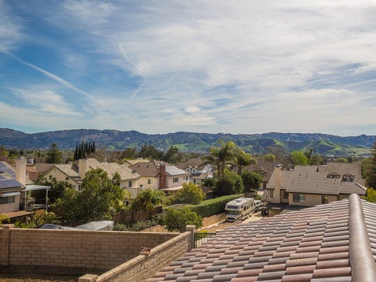 The homes offer views of the valley below and