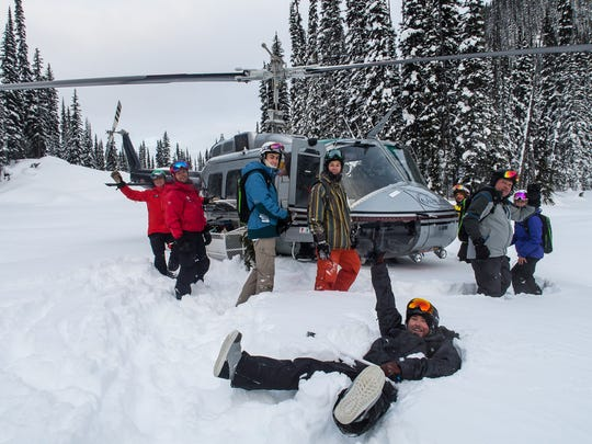 Heli-skiers and guides prepare to board their chopper for another trip up the mountain with Selkirk Tangiers near Revelstoke. (Brad Kasselman/Chicago Tribune/TNS)