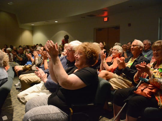 """The audience applauds marine biologist and science educator Ellen Prager's talk. She spoke at the Rookery Bay Envioronmental Learning Center on Feb. 9 as part of the """"Tales from the Coast"""" lecture series."""
