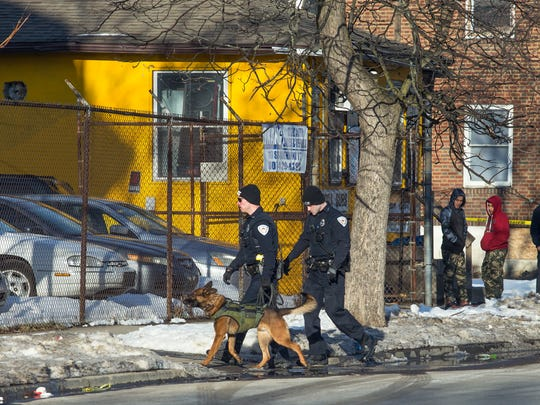 A police K-9 near the scene of a shooting inside a deli at 121 Susquehanna St. in Binghamton on Friday. Four people were shot but police say none of the injuries were believed to be life threatening.