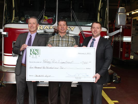 Rahway: Donation from RSI Bank will ensure continued safety of Rahway's firefighters PHOTO CAPTION