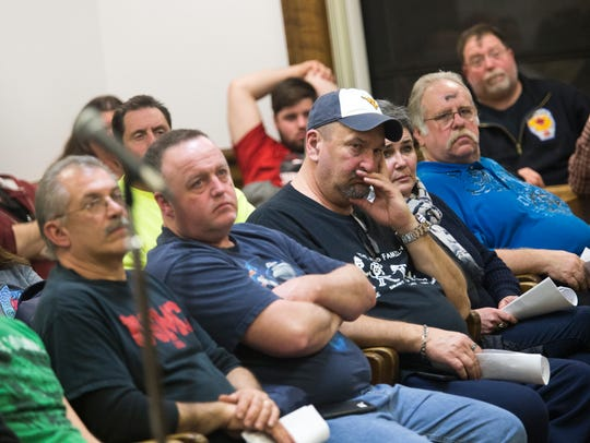Town of Union residents listen during a town board
