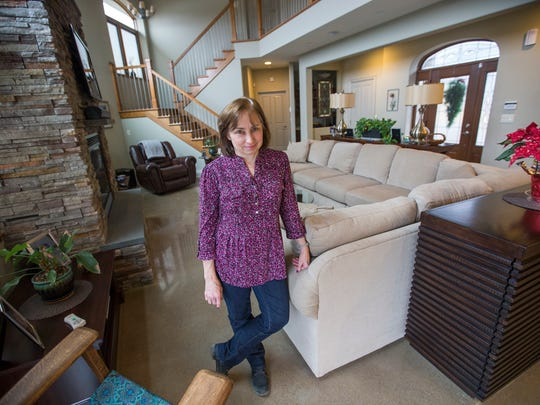Mary Murphy Harrison stands in the living room of her 4,400 square-foot Vestal home which was built with insulated concrete form construction.