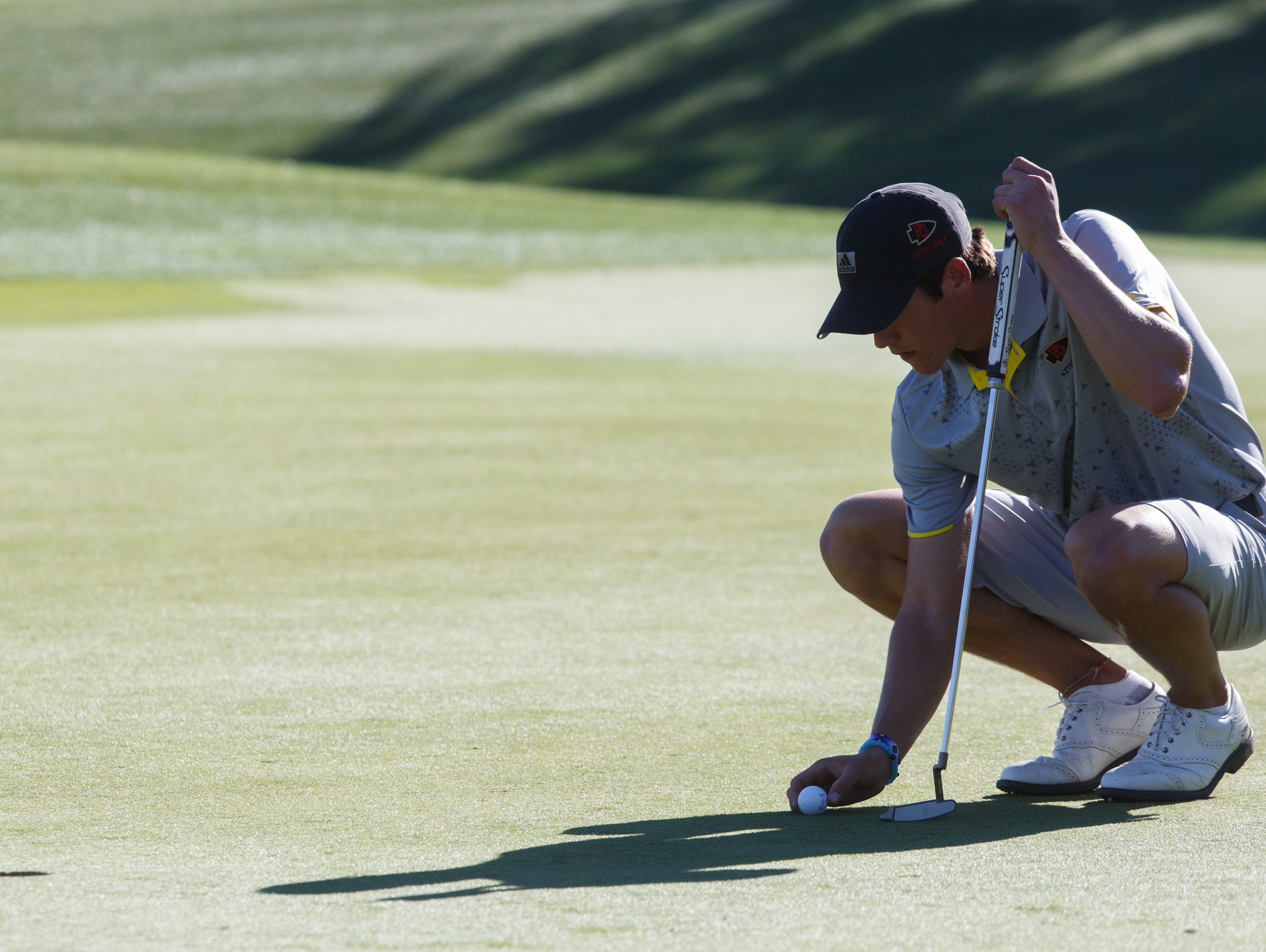 Charlie Reiter prepares for a putt in a game against Palm Desert at the Classic Club in Palm Desert, Calif., Tuesday, March 7, 2017.