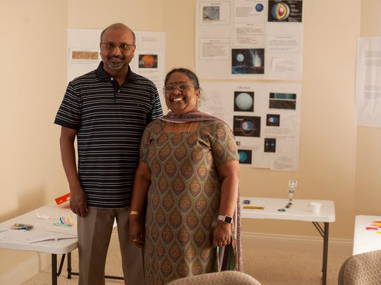 Uma Umakanth and his wife Suseela pose for a portrait in their classroom in their basement of their home in Okemos on Monday, March 6, 2017.