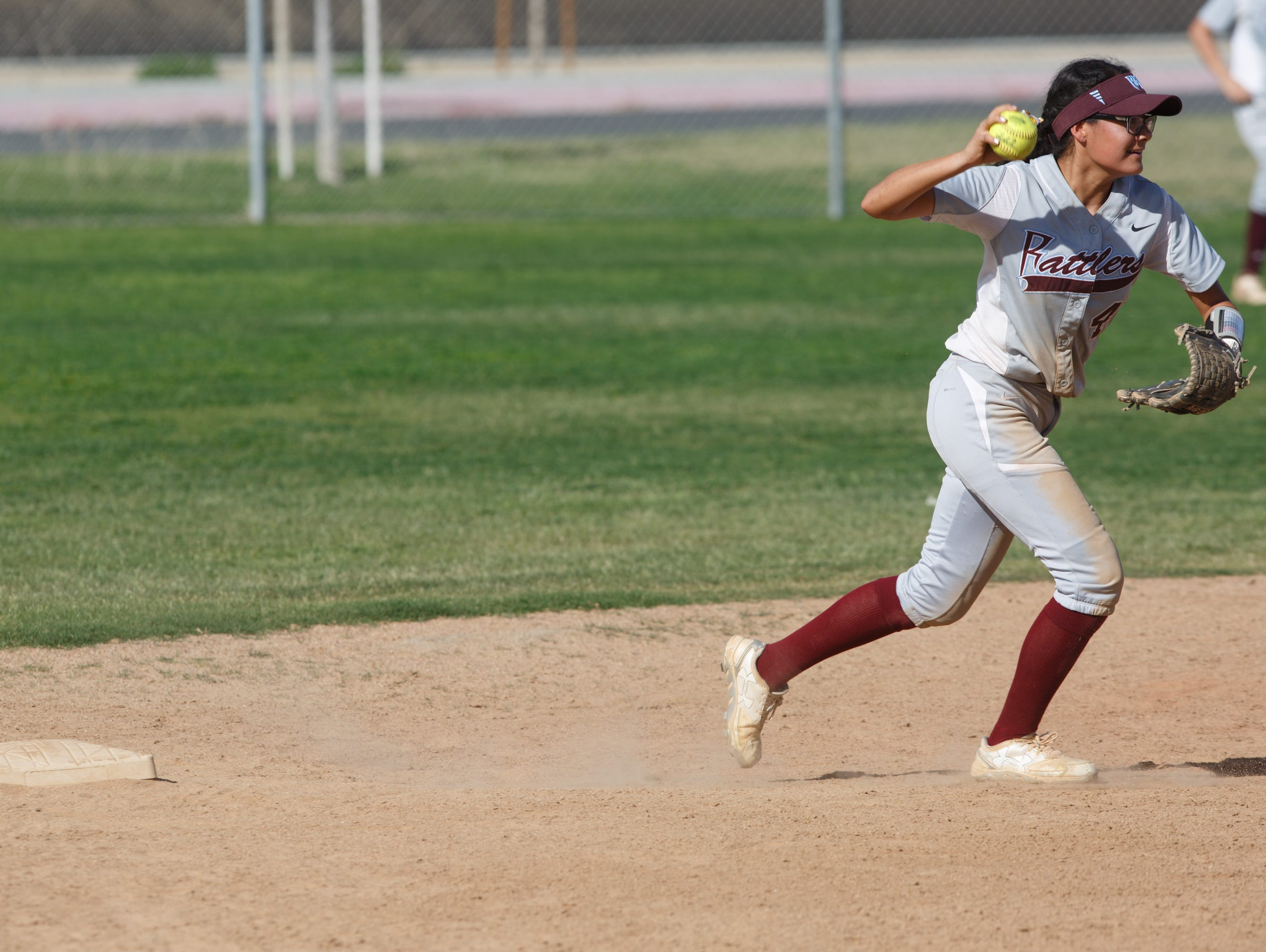 Alejandra Ramirez throws to first base for an out against the Blackhawks at La Quinta High School, Tuesday, March 14, 2017.
