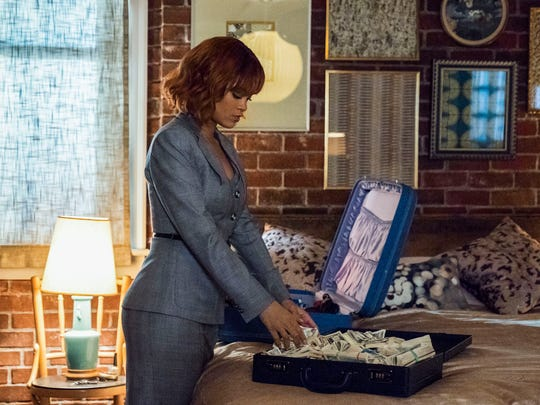 Marion Crane (Rihanna) packs for what she expects will
